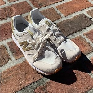 New white/gold new balance shoes.  Size 8